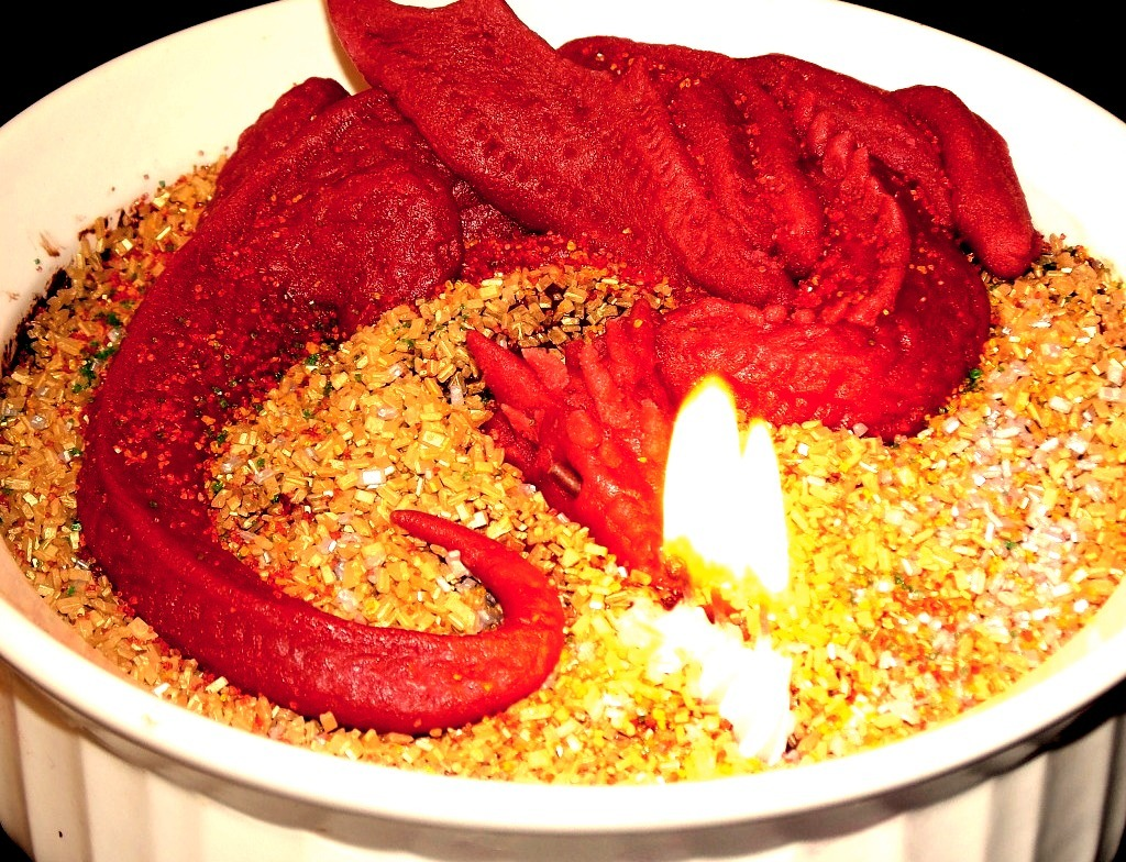 Marzipan Smaug atop a treasure of golden sprinkles and rich chocolate souffle. As fun to eat as he was to make!